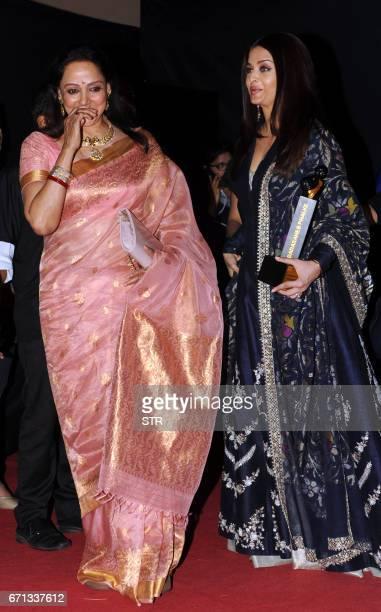 Indian Bollywood actress Hema Malini speaks with Aishwarya Rai Bachchan as they attend the Dadasaheb Phalke Excellence Awards Ceremony 2017 in Mumbai...