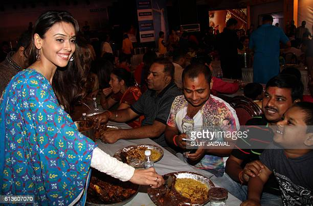 Indian Bollywood actress Hrishitaa Bhatt gestures at the serving of Bhog sacred food during celebrations at the North Bombay Sarbojanin Durga Puja in...