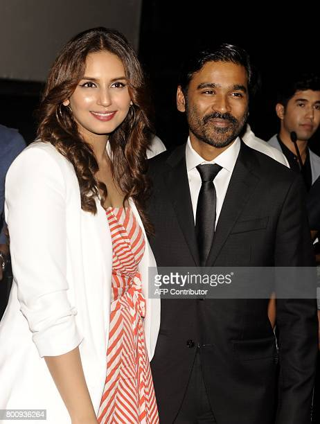 Indian Bollywood actress Huma Qureshi and Dhanush attend the trailer and music launch of the upcoming film VIP 2' in Mumbai on June 25 2017 / AFP...