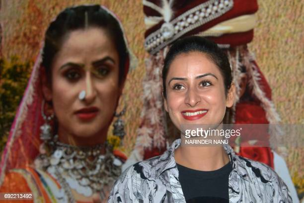 Indian Bollywood actress Jaspinder Cheema poses at a promotional event for the forthcoming film 'Ek Anokhi Dulhan Saavi' in Amritsar on June 4 2017 /...