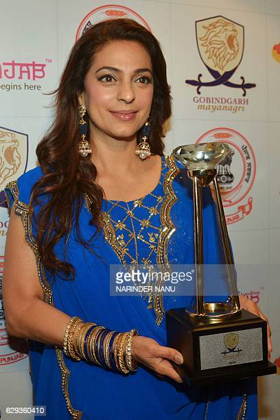 Indian Bollywood actress Juhi Chawla holds a trophy presented during an inauguration ceremony of the historic Gobindgarh fort in Amritsar on December...