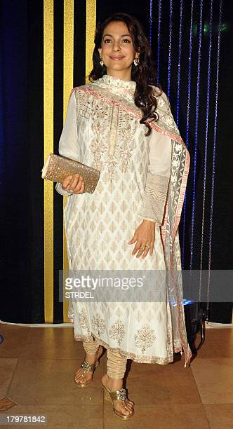 Indian Bollywood actress Juhi Chawla poses during the 64th birthday celebrations for Indian Bollywood director Rakesh Roshan in Mumbai on September 6...