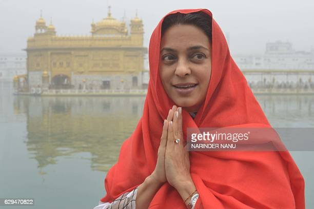 Indian Bollywood actress Juhi Chawla visits the Sikh Golden Temple in Amritsar on December 13 2016 Chawla visited the city to attend the inauguration...