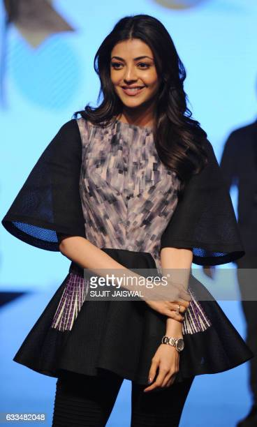 Indian Bollywood actress Kajal Aggarwal poses for a photograph during Lakmé Fashion Week Summer Resort 2017 in Mumbai on late Februsry 1 2017 / AFP /...