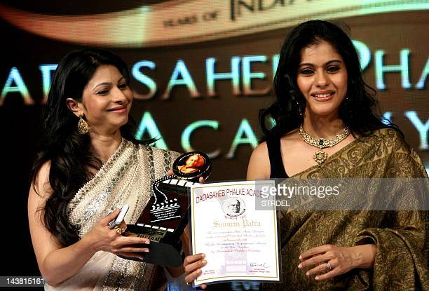"Indian Bollywood actress Kajol and her sister Tanisha attend the ""143rd Dadasaheb Phalke Academy Awards 2012"" ceremony celebrating Indian Cinema in..."