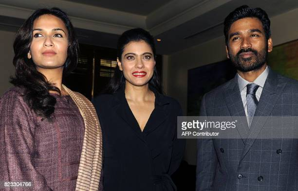 Indian Bollywood actress Kajol Devgn and South Indian actor Dhanush pose for a photograph during a promotional event for the forthcoming Hindi film...