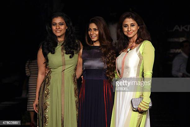 Indian Bollywood actress Kajol Devgn her sister actress Tanisha Mukherjee and actress Urmila Matondkar pose for a photograph on the first day of the...