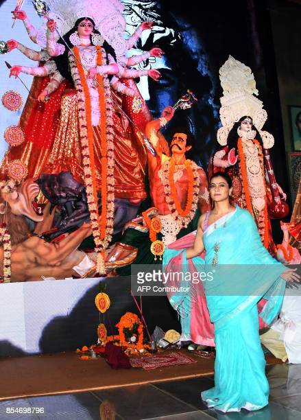 Indian Bollywood actress Kajol Devgn poses for a photo during 'Durja Puja' celebrations in the North Bombay Sarbojanin Durga Puja Samiti in Mumbai on...