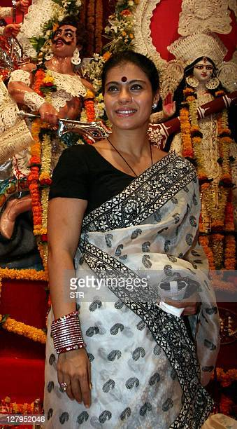 Indian Bollywood actress Kajol Devgn poses for a photo during the Sarbojani Durga Puja Festival celebrations in Mumbai on October 3 2011 AFP PHOTO/...