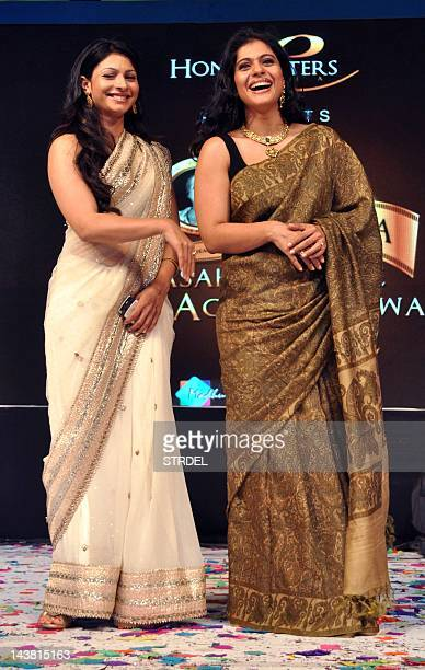 "Indian Bollywood actress Kajol with sister Tanisha attend the ""143rd Dadasaheb Phalke Academy Awards 2012"" ceremony celebrating Indian Cinema in..."