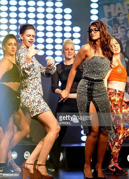 Indian Bollywood actress Kalki Koechlin and Ileana D'Cruz perform during the music launch of the upcoming Hindi film Happy Ending in Mumbai on...