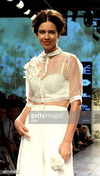 Indian Bollywood actress Kalki Koechlin showcases a creation by designer Nishika Lulla on the fourth day of the Lakme Fashion Week summer/resort 2015...