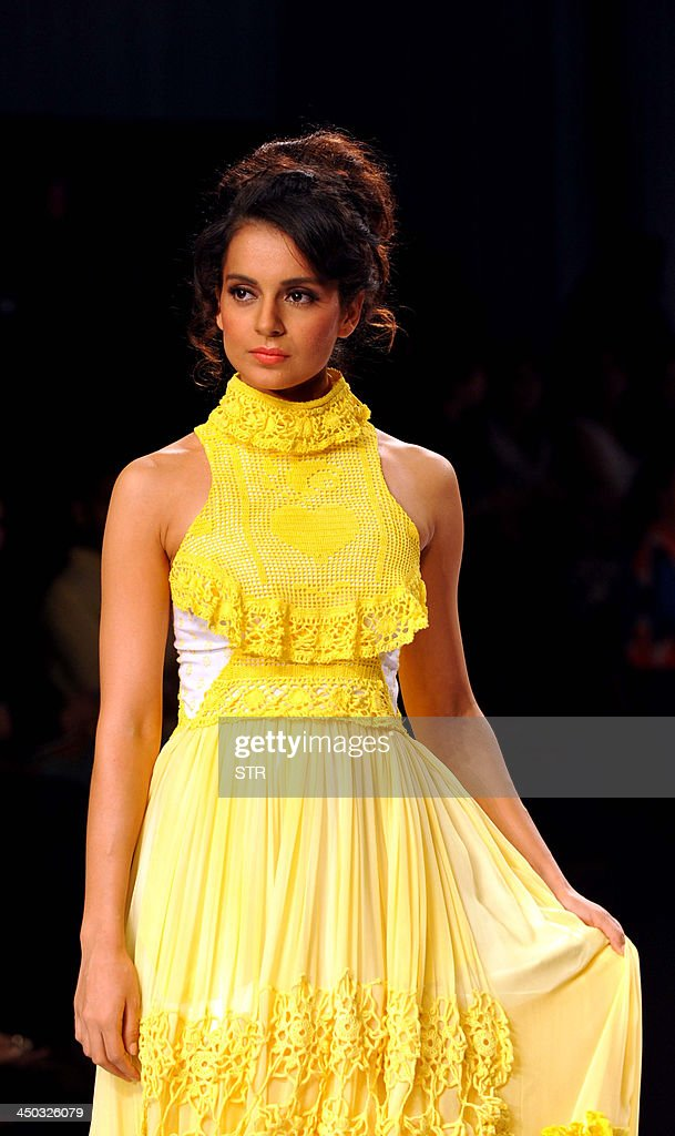 Indian Bollywood actress <a gi-track='captionPersonalityLinkClicked' href=/galleries/search?phrase=Kangana+Ranaut&family=editorial&specificpeople=4325041 ng-click='$event.stopPropagation()'>Kangana Ranaut</a> models a creation by designer by Bora Aksu during the 'Signature International Fashion Week End in Mumbai on November 17, 2013.