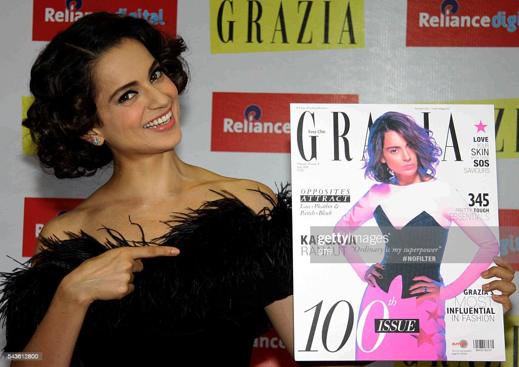 Indian Bollywood actress Kangana Ranaut poses during the launch of Grazia magazine's 100th Issue, in Mumbai on June 29, 2016. / AFP / STR