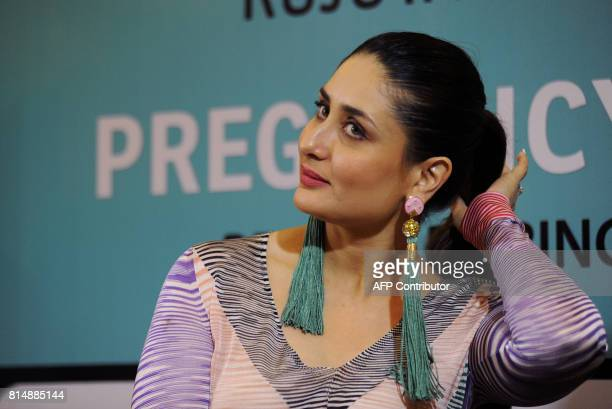 Indian Bollywood actress Kareena Kapoor Khan looks on during the launch of the book 'Pregnancy Notes before during after' author by Rujuta Diwekar in...