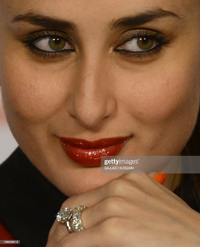 Indian Bollywood actress Kareena Kapoor Khan looks on while her engagement ring and wedding band are seen worn on her finger during a press conference ahead of the 58th Idea Filmfare Awards, to be held January next year, in New Delhi on December 18, 2012. AFP PHOTO/SAJJAD HUSSAIN