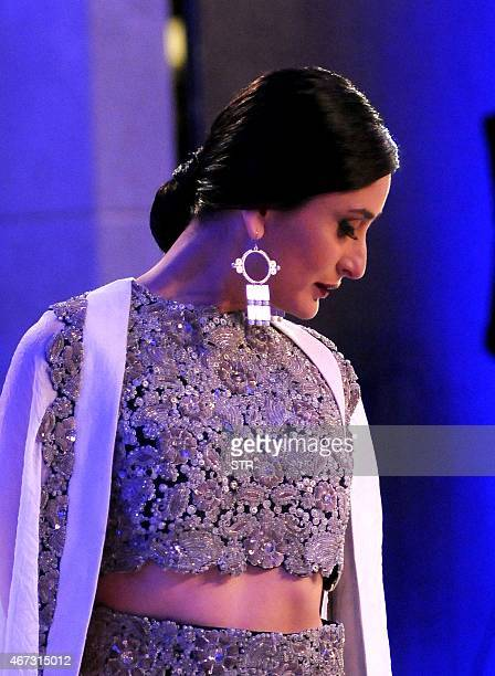 Indian Bollywood actress Kareena Kapoor Khan showcases a creation by designer Anamika Khanna during the grand finale of the Lakme Fashion Week...