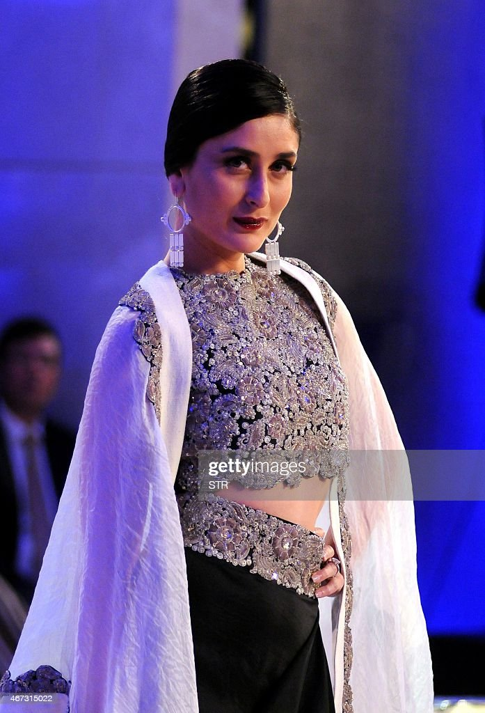 Indian Bollywood actress <a gi-track='captionPersonalityLinkClicked' href=/galleries/search?phrase=Kareena+Kapoor&family=editorial&specificpeople=855270 ng-click='$event.stopPropagation()'>Kareena Kapoor</a> Khan showcases a creation by designer Anamika Khanna during the grand finale of the Lakme Fashion Week (LFW) summer/resort 2015 in Mumbai on March 22, 2015.