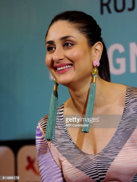Indian Bollywood actress Kareena Kapoor Khan smiles during the launch of the book 'Pregnancy Notes before during after' author by Rujuta Diwekar in...
