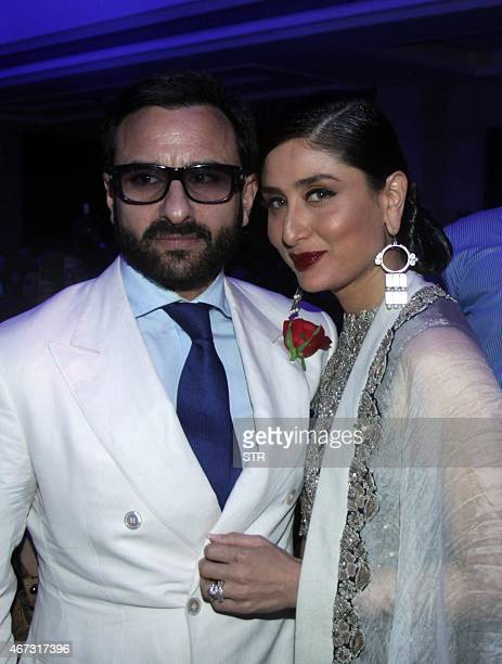 Indian Bollywood actress Kareena Kapoor Khan with her husband Saif Ali Khan showcases a creation by designer Anamika Khannaduring the grand finale of...