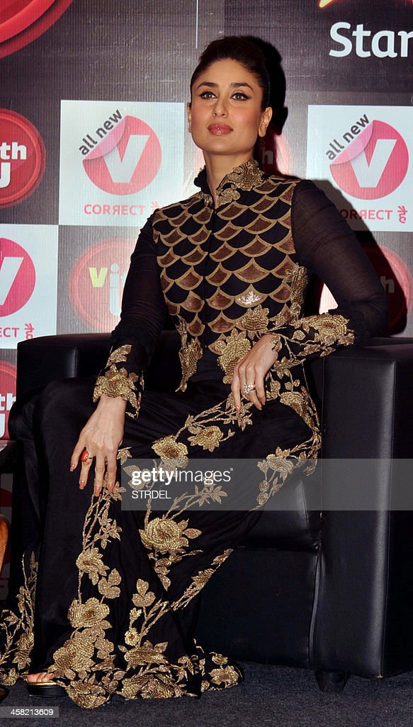 Indian Bollywood actress Kareena Kapoor looks on during an event for a mobile phone app to promote women's safety in Mumbai on late December 20, 2013.