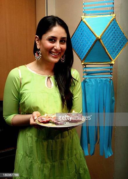 "Indian Bollywood actress Kareena Kapoor poses as she prepares to celebrate ""Diwali"" the Hindu festival of Light in Mumbai on October 25 2011 AFP..."