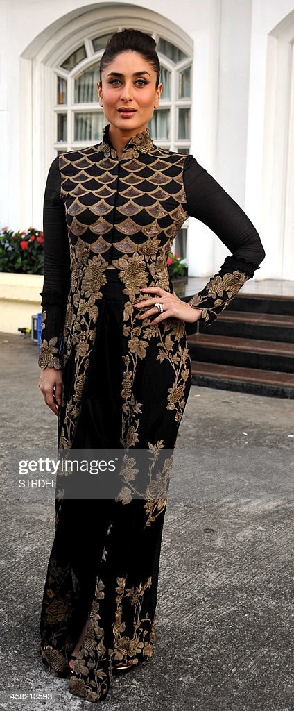 Indian Bollywood actress Kareena Kapoor poses for a photograph during an event for a mobile phone app to promote women's safety in Mumbai on late December 20, 2013.