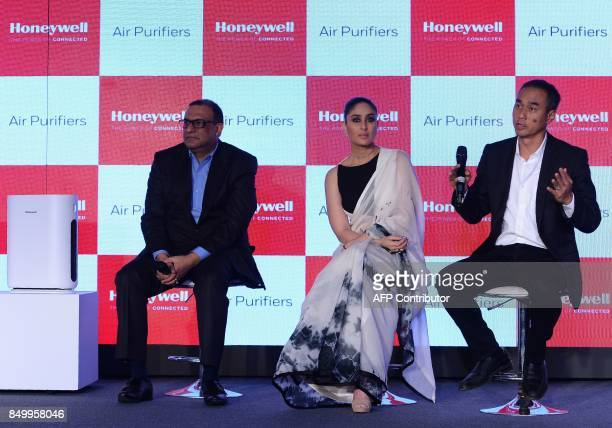 Indian Bollywood actress Kareena KapoorKhan President of Honeywell in India Vikas Chadha and VicePresident and General Manager for Homes in greater...