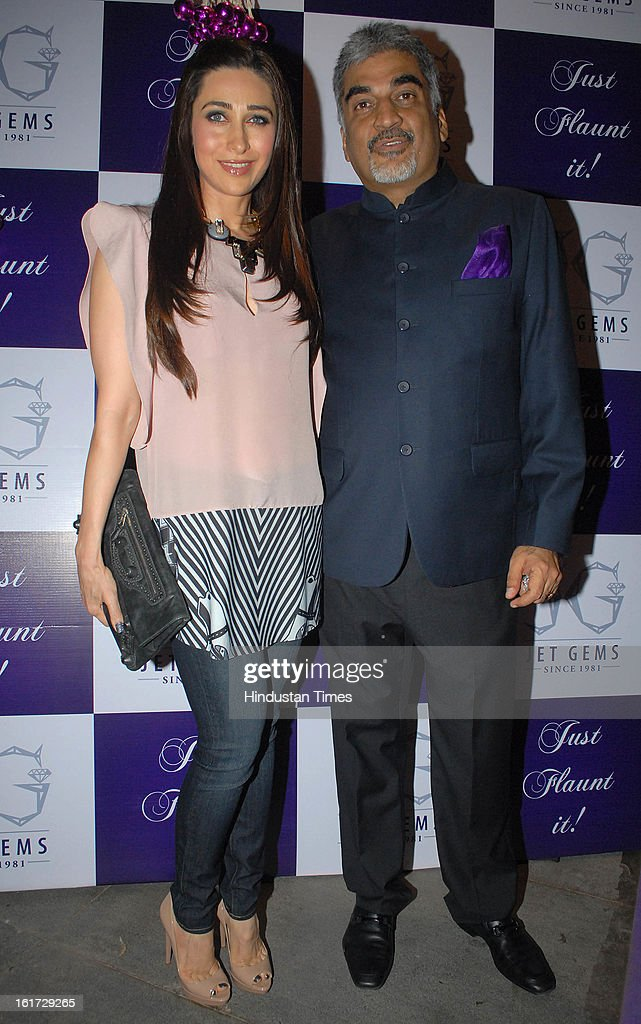Indian bollywood actress Karisma Kapoor with Pradeep Jethani during the launch of Pradeep Jethani's flagship store 'Jet Gems' at Turner Road, Bandra on February 13, 2013 in Mumbai, India.