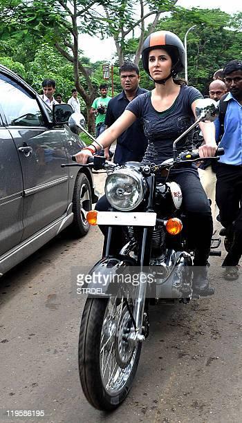 Indian Bollywood actress Katrina Kaif rides a Royal Enfield motorcycle during a promotional event for the film 'Zindagi Na Milegi Dobara' in Mumbai...