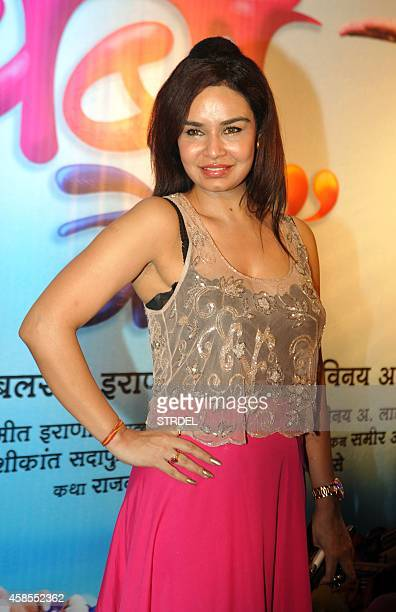 Indian Bollywood actress Kavita Verma poses as she attends the premiere of Marathi film Bol Baby Bol directed by late Vinay Laad in Mumbai late...