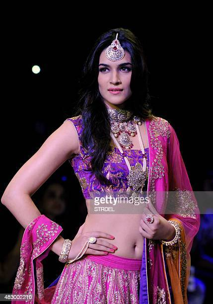 Indian Bollywood actress Kirti Sanon showcases a creation during India International Jewellery Week 2015 in Mumbai on August 5 2015 AFP PHOTO