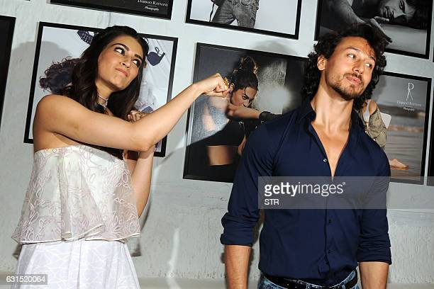 Indian Bollywood actress Kriti Sanon and actor Tiger Shroff pose as they attend the launch of Daboo Ratnani's Celebrity Calendar 2017 in Mumbai late...