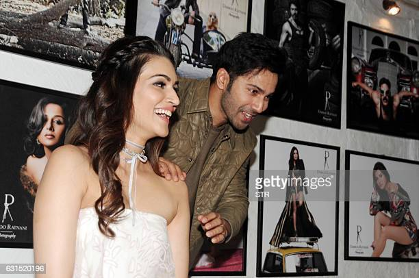 Indian Bollywood actress Kriti Sanon and actor Varun Dhawan pose as they attend the launch of Daboo Ratnani's Celebrity Calendar 2017 in Mumbai late...