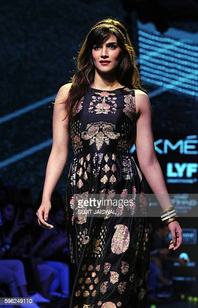 Indian Bollywood actress Kriti Sanon showcases a creation by designer Ritu Kumar during the Lakme Fashion Week Winter/Festive 2016 in Mumbai on...