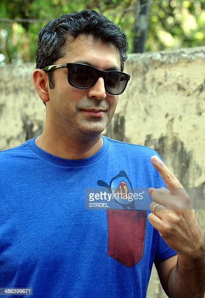 Indian Bollywood actress Kunal Kholi poses for a photograph after casting his vote at a polling station in Mumbai on April 24 2014 India's...