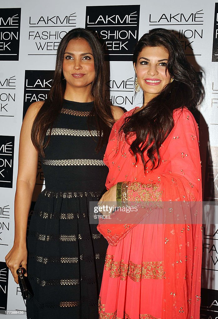 Indian Bollywood actress Lara Dutta (L) and Jacqueline Fernandez attend the Lakme Fashion Week (LFW) Winter/Festival 2013 in Mumbai on August 22, 2013.