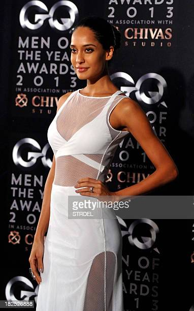 Indian Bollywood actress Lisa Haydon poses as she attends the GQ India fifth anniversary 'Men of the Year' Awards ceremony in Mumbai late September...
