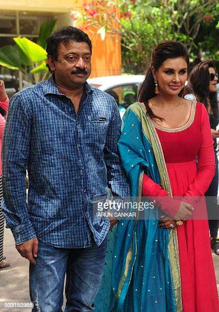 Indian Bollywood actress Lisa Rayand director Ram Gopal Varma pose during a promotional event for the film 'Veerapan' in Chennai on May 21 2016 / AFP...