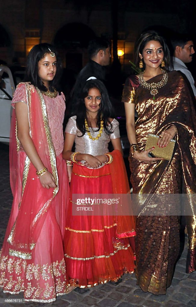 Indian Bollywood actress Madhu (R) poses with her daughters as they attend the wedding reception of actress Ahana Deol and husband Vaibhav Vohra in Mumbai on February 2, 2014.