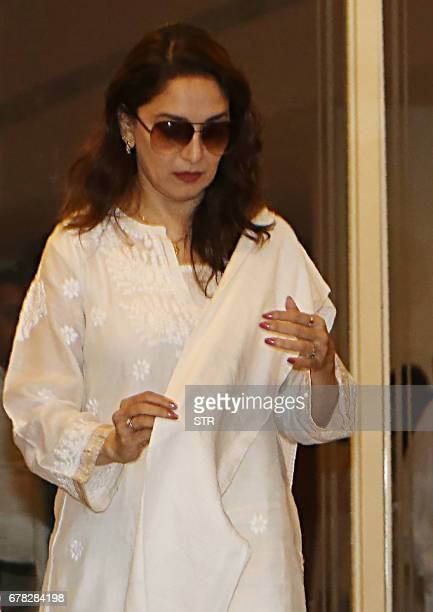 Indian Bollywood actress Madhuri Dixit arrives to attend a prayer meeting for the late actor and politician Vinod Khanna in Mumbai on May 3 2017 /...
