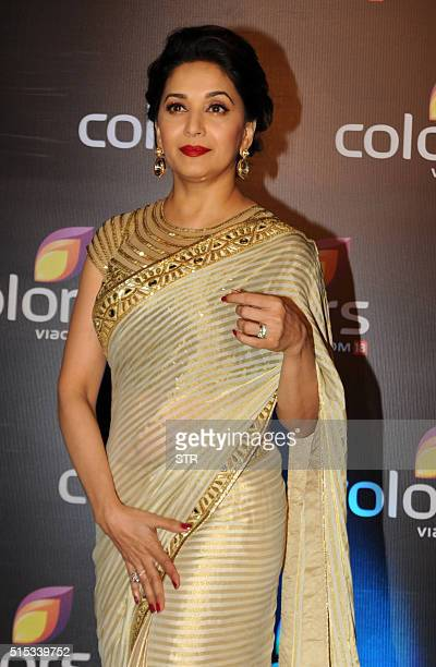 Indian Bollywood actress Madhuri Dixit Nene poses as she attends The Colors Television Annual Party in Mumbai late March 12 2016 / AFP / STR
