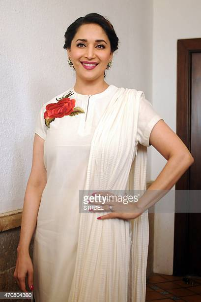 Indian Bollywood actress Madhuri Dixit poses for a photograph during a promtional event for a dance event in Mumbai on April 23 2015 AFP PHOTO / STR