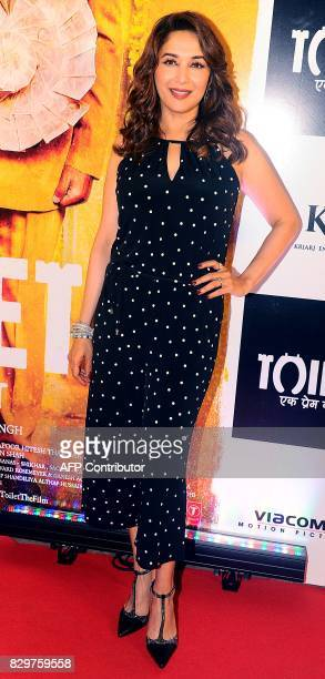 Indian Bollywood actress Madhuri Dixit poses for a photograph during a screening of Hindi film 'Toilet Ek Prem Katha' in Mumbai on August 10 2017 /...