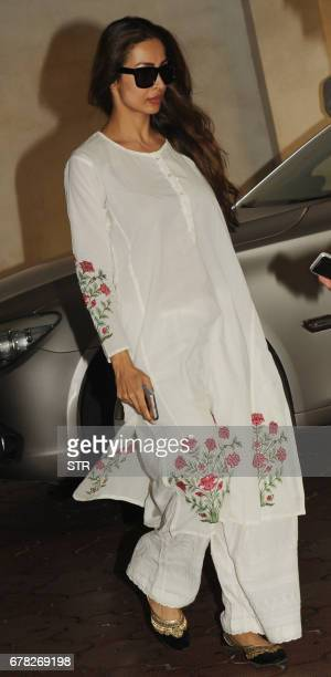 Indian Bollywood actress Malaika Arora arrives to attend a prayer meeting for the late actor and politician Vinod Khanna in Mumbai on May 3 2017 /...