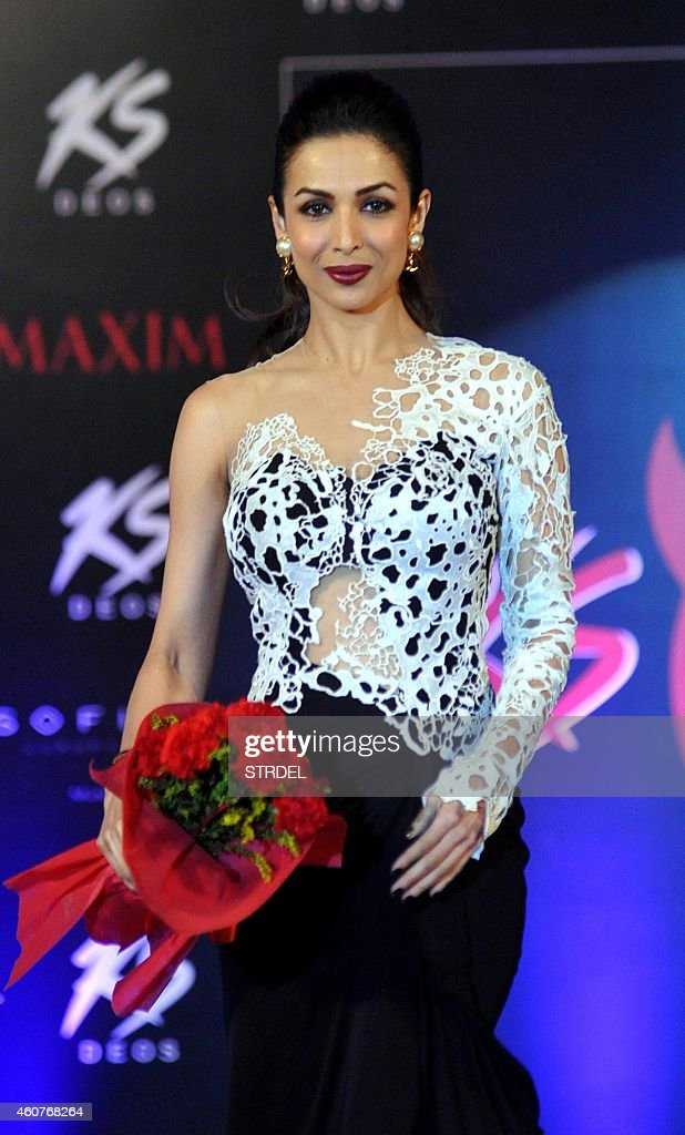 Indian Bollywood actress <a gi-track='captionPersonalityLinkClicked' href=/galleries/search?phrase=Malaika+Arora+Khan&family=editorial&specificpeople=884958 ng-click='$event.stopPropagation()'>Malaika Arora Khan</a> attends the 2015 Miss Maxim pageant event as a judge in Mumbai on December 21, 2014.