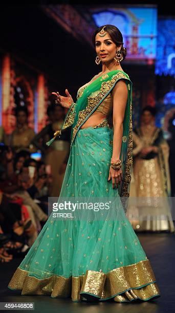 Indian Bollywood actress Malaika Arora Khan showcases a creation by designer Vikram Phadnis during Madame Style Week 2014 in Mumbai on November 22...