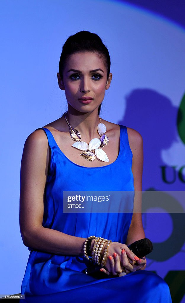 Indian Bollywood actress Malaika Arora Khan speaks with the media during the launch of the charity-themed campaign 'Taiwan Excellence Cares' in Mumbai on September 2, 2013.AFP PHOTO/ STR