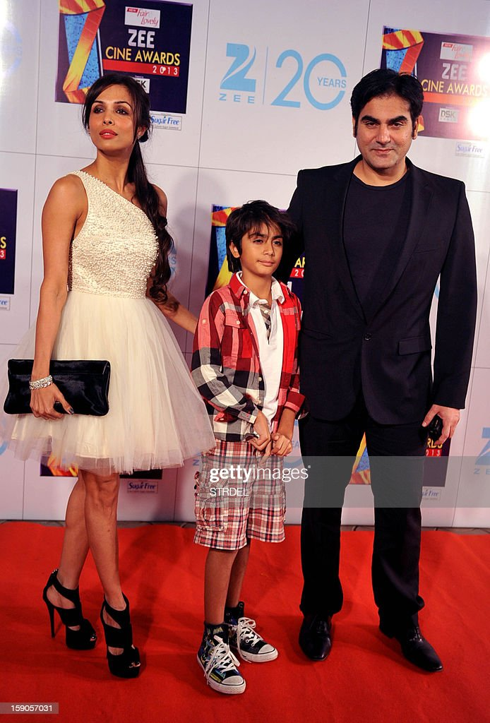 Indian Bollywood actress Malaika Arora Khan with husband Arbaaz Khan and son attend the Zee Cine Awards 2013 ceremony in Mumbai on January 6, 2013.
