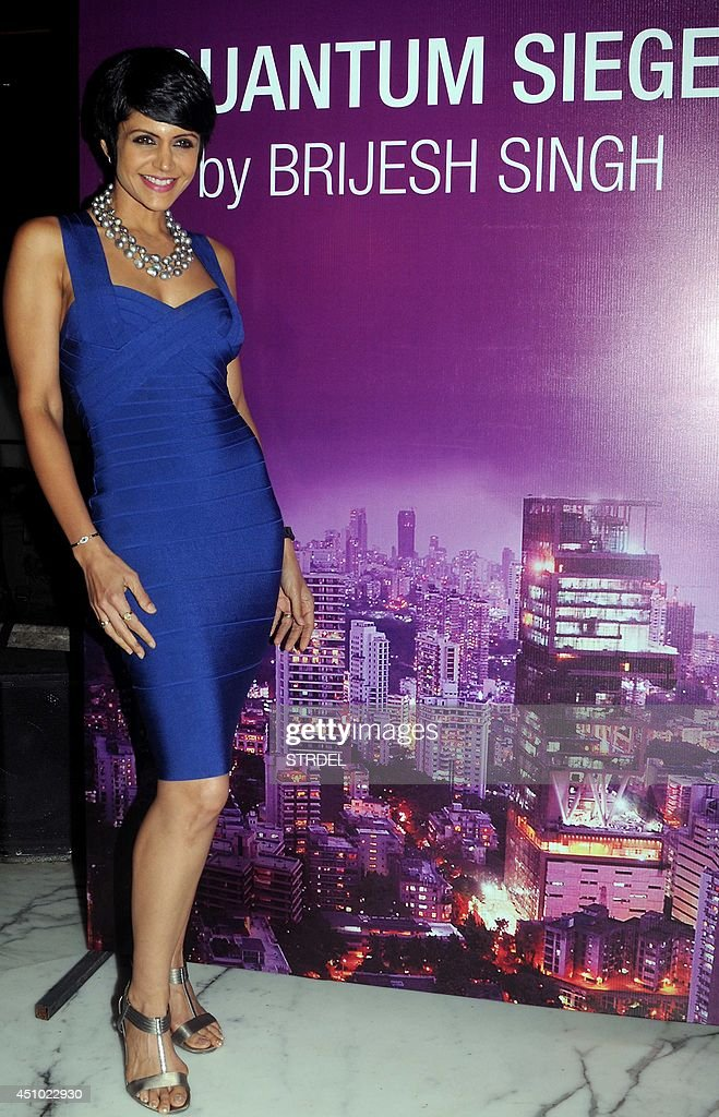 Indian Bollywood actress <a gi-track='captionPersonalityLinkClicked' href=/galleries/search?phrase=Mandira+Bedi&family=editorial&specificpeople=703799 ng-click='$event.stopPropagation()'>Mandira Bedi</a> poses during the launch of Mumbai DIG - Rank IPS Officer Brijesh Singh's book 'Quantum Siege' in Mumbai on June 21, 2014.